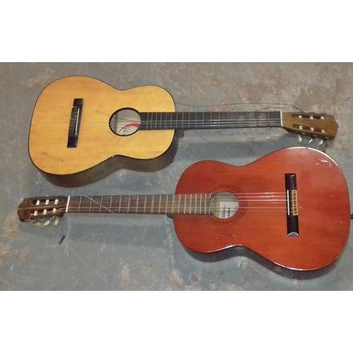 144 - 2 x full size acoustic guitars being Sagadia and Tatra, both need restringing...
