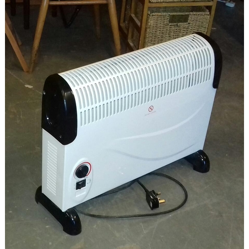 434 - Morrisons 1800 wt floor stand portable storage heater...