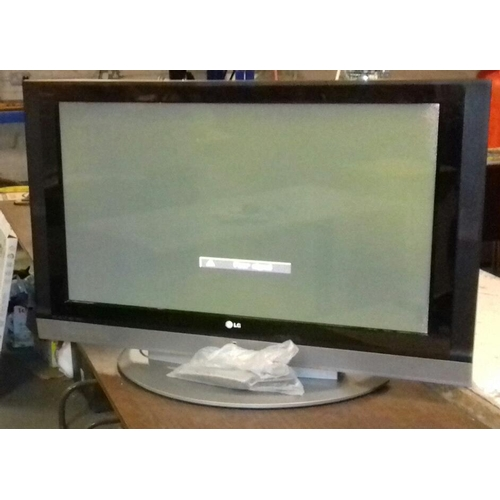 457 - LG 42 inch plasma television with remote and cables, intermittently pixelates so sold as spare or re...