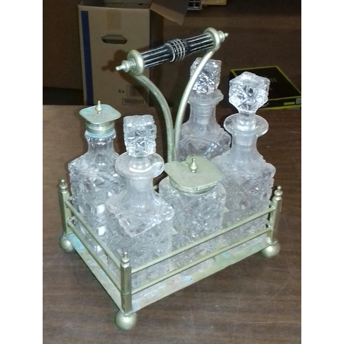 117 - Cut glass cruet set on brass stand...