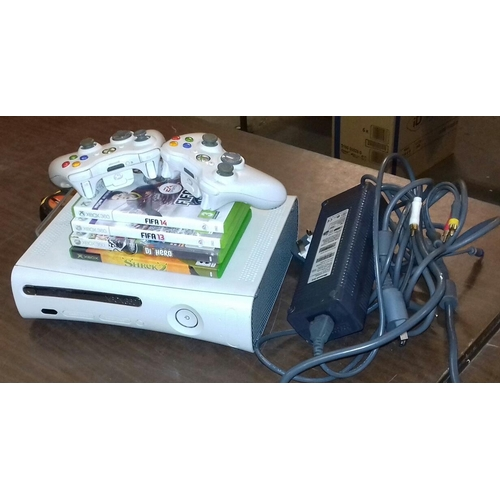 53 - Xbox gaming console, two controllers and 4 games...