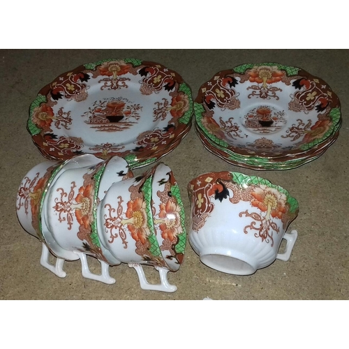 80 - Vintage set of four cups, four saucers and three matching side plates...