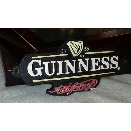 76 - Approx. 28 x 12 cm cast iron Guinness sign...
