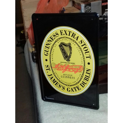 247 - 30 x 20 cm Guinness tin sign...