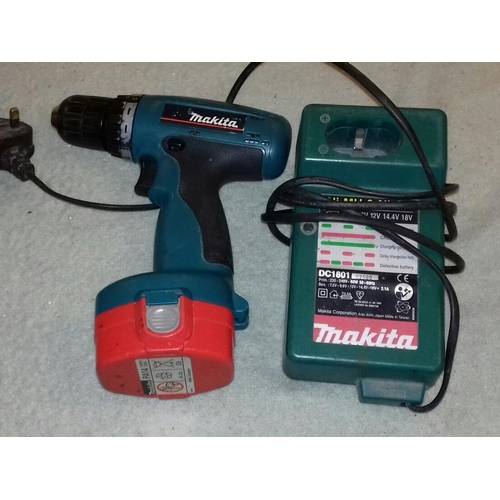 241 - Makita 14.4 v drill with battery and charger, not charging so sold as spare or repair...