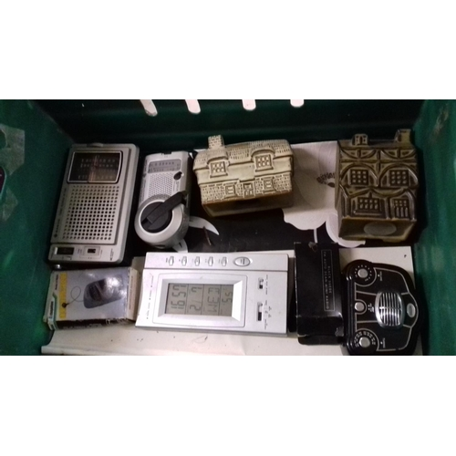 244 - Box of assorted radios with two x Tremar money boxes...