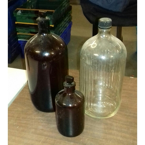 200 - 3 x assorted apothecary bottles with lids tallest being 32 cm...