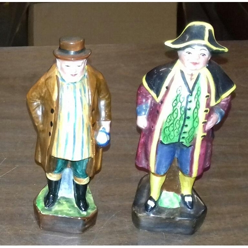 31 - Pair of 14 cm tall Dickensian ceramic figures...