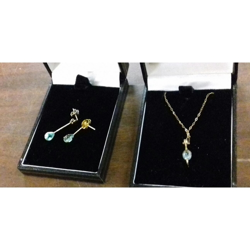 575 - Hallmarked 9 carat necklace with aquamarine pendant and matching set of earrings...
