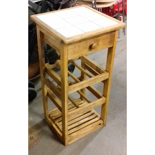 509 - 38 x 38 x 78 cm light wood bottle stand with tiled top...