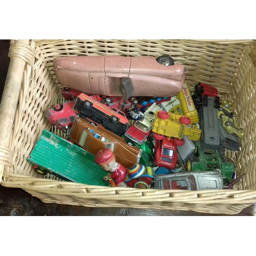 308 - Basket of assorted vintage toy vehicles, all play worn...