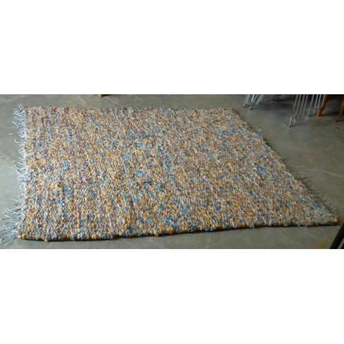 191 - Approx. 218 x 178 cm old heavy multi-coloured woollen rug...