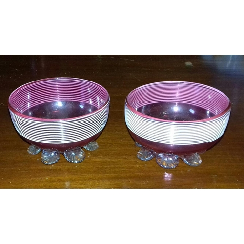 40 - Pair of Edwardian 3 inch diameter cranberry glass dishes...