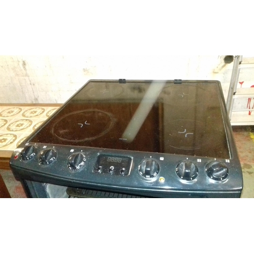 508 - Zanussi black electric cooker model number ZCV662MNC...
