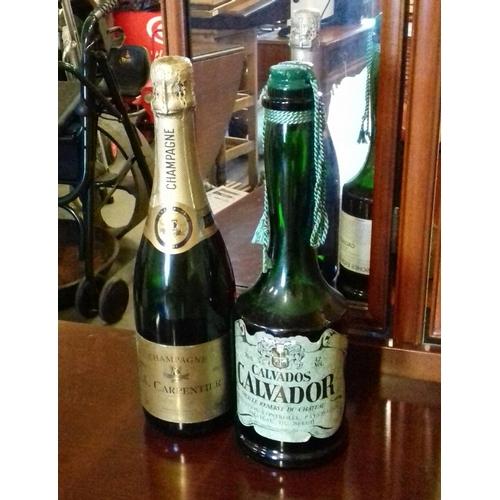 136 - Unopened 750 ml A.Carpentier Brut champagne and 70 cl Calvados calvador brandy...