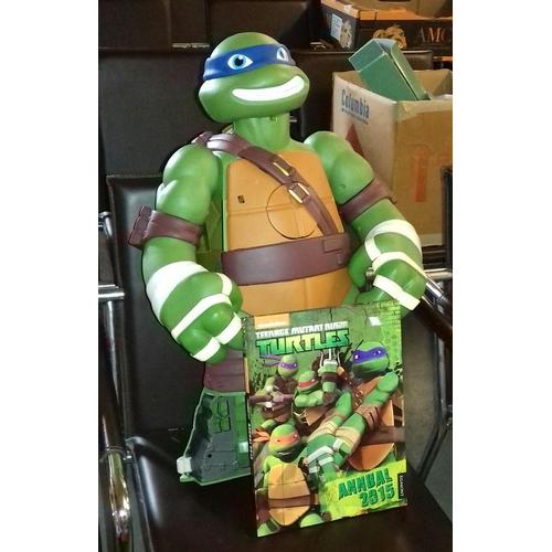 237 - 2 ft tall plastic Leonardo Ninja Turtle figure and annual...