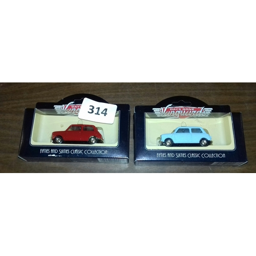 314 - 2 x boxed Vanguards days gone 1959 Austin seven Minis, model numbers 74000 and 74001, different colo...