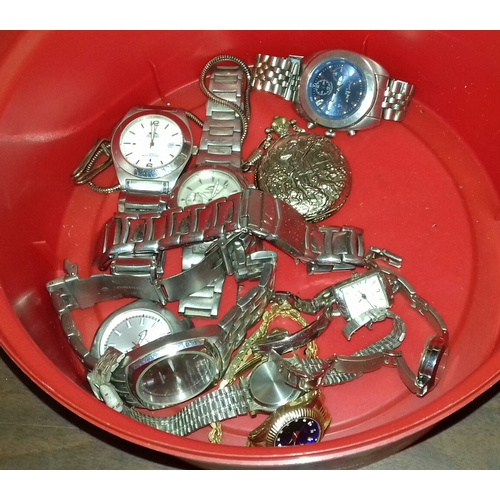 315 - Plastic tub with assorted ladies and gents wrist watches and pocket watch to include Slazenger, Saba...