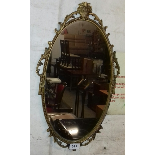 511 - Approx 67 x 39 cm ornate gilt metal framed wall mirror...