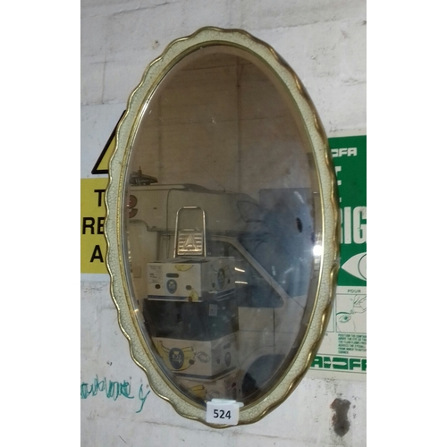 524 - Vintage 37 cm oval bevelled glass wall mirror with cracked paint effect and gilt edging...