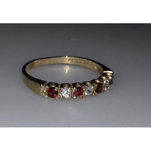 34 - 9 ct hallmarked 4 garnet and 3 CZ alternate stone dress ring size N...