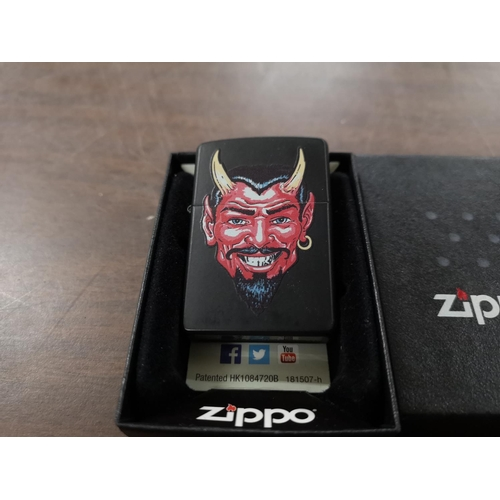 10 - Double sided Zippo lighter, devils face/skull with spanner crossbones, in case...