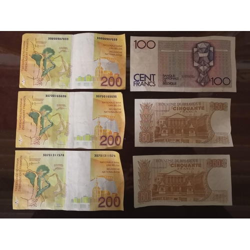 12 - Bundle of vintage Belgian Franc banknotes, 3 x 200, 1 x 100 and 2 x 50...