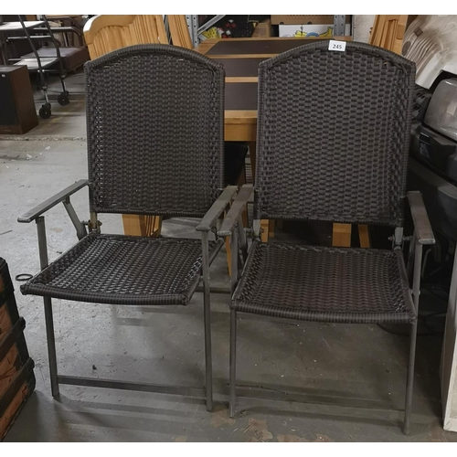 245 - Pair of metal and rattan folding patio chairs...