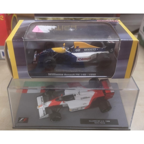 26 - 2 x Formula One model racing cars in perspex cases...
