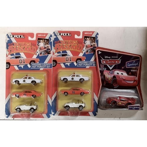 42 - 2 x new and carded ERTL Dukes of Hazzard hot pursuit sets & Disney Cars Lightning Mcqueen...