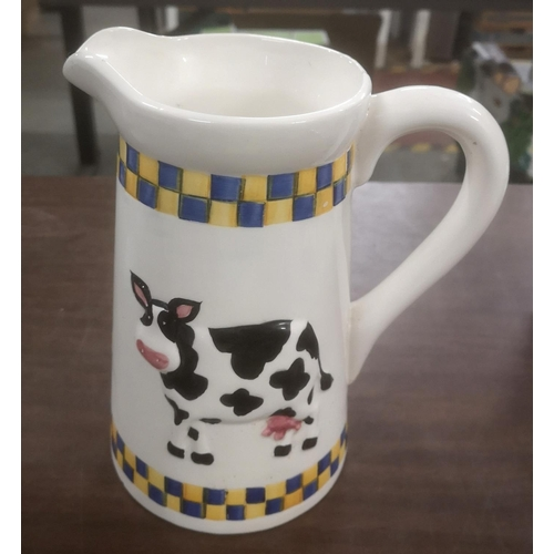 22 - 22 cm tall Rayware jug with embossed cow detail...