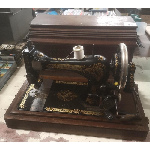 54 - Early 1900's singer 28k manual sewing machine with wooden case...