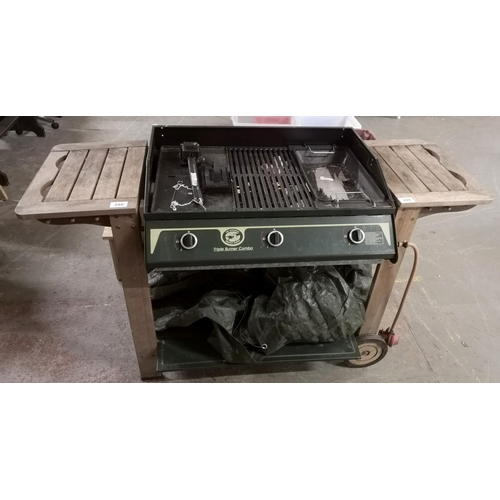 286 - The Australian Barbecue Co triple burner combo with tarpaulin cover and cleaning tools...