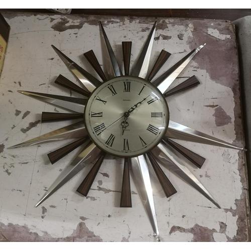 6 - Metamec quartz sunburst wall clock, 2 x metal 'sunbeams' missing...