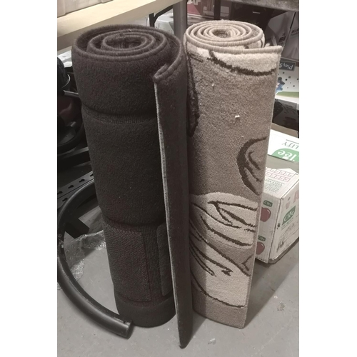 5 - 2 x Crossley stain resistant rugs being patterned and brown block, both approx 150 x 80 cm...