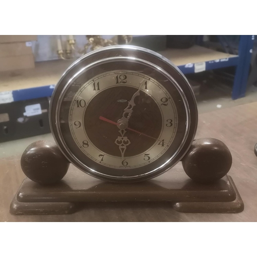 321 - 31 x 7 x 21 cm tall Art Deco Metamec mantle clock with converted quartz movement...