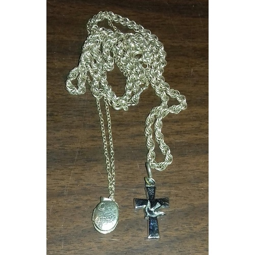 49 - 2 x unstamped white metal chains with locket and cross pendants...