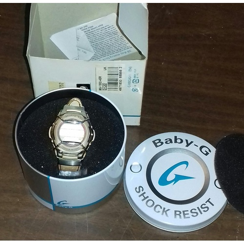 11 - Baby G shock resistant watch in tin...