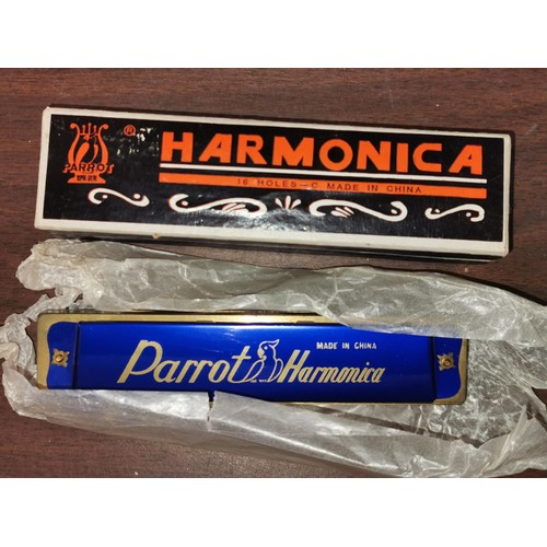 25 - New and boxed Parrot china harmonica...