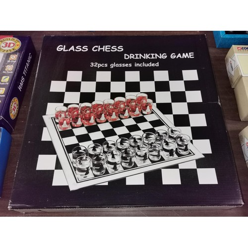 36 - New and boxed glass chess drinking game...