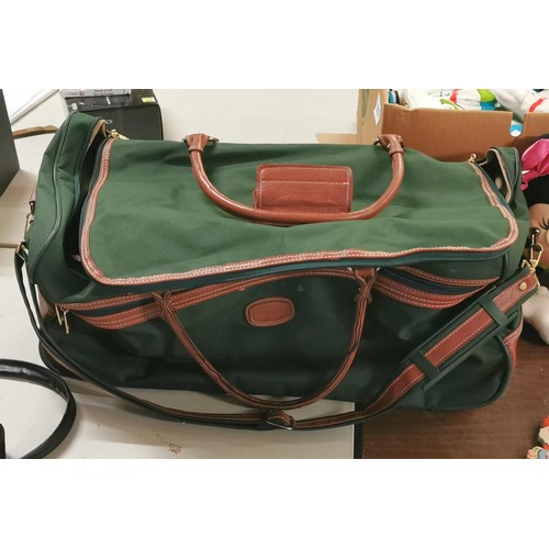 44 - Large M&S green canvas and tan leather holdall on wheels...