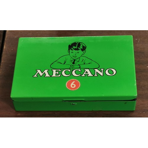 13 - Small vintage Meccano tin with some contents and wheels...