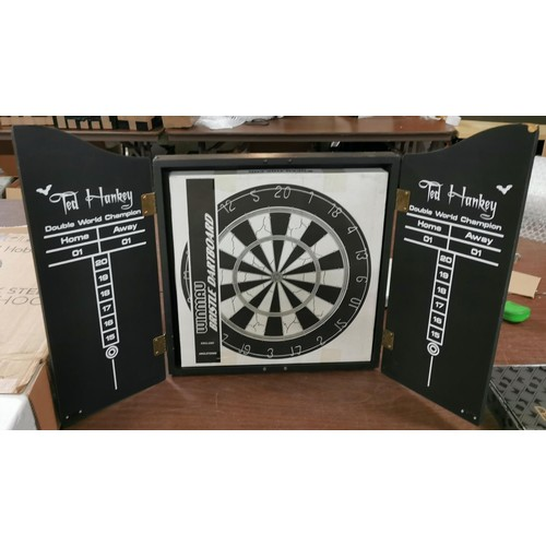 41 - New and boxed Winmau bristle dart board in scoreboard cabinet...