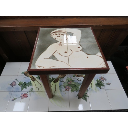 14 - Small tiled table depicting a naked lady H x 43 x W x 30 D x 30....