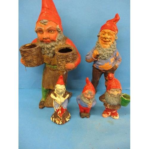 Five 1920s/30s terracotta and ceramic garden gnomes