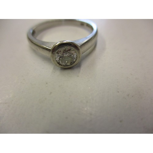 19 - A platinum diamond solitaire ring, approx. ring size L