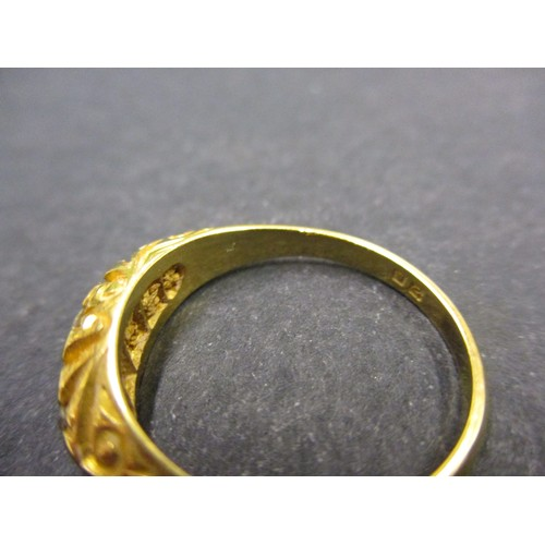 23 - An 18ct yellow gold ring, with 5 graduated diamonds. Approximate ring size O