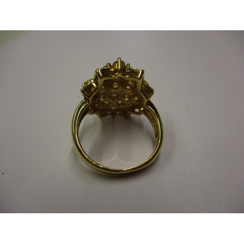 25 - An 18k gold and diamond cluster ring. Approximate ring size N 1/2.