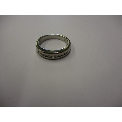 28 - A platinum and diamond ring. Approximate ring size R
