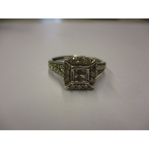 29 - A white gold and diamond ring. Approximate ring size S